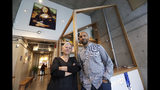 "In this Wednesday, Oct. 9, 2019 photo, marijuana retail shop Village Bloomery owners Andrea Dobbs, left, and her husband Jeremy Jacob pose for a photo in their store in Vancouver, B.C. ""One customer told me, 'I love you and I want to support you, but I can't buy all my cannabis here. It's too expensive,'"" said Jacob. ""The black-market producers are being well rewarded by legalization."" (AP Photo/Elaine Thompson)"