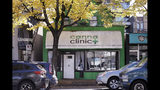 In this Wednesday, Oct. 9, 2019 photo, cars drive past the Canna Clinic, an unlicensed marijuana shop, in Vancouver, B.C. The nation has seen no sign of increases in impaired driving or underage use since Canada joined Uruguay as the only nations to legalize and regulate the sale of cannabis to adults _ those over 19 in most Canadian provinces. (AP Photo/Elaine Thompson)