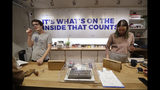 In this Wednesday, Oct. 9, 2019 photo, bloom tenders Rian Bevan, left, and Wallis Hartley assist customers at the Village Bloomery, a marijuana retail shop, in Vancouver, B.C. (AP Photo/Elaine Thompson)