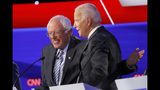 Democratic presidential candidate Sen. Bernie Sanders, I-Vt., left, and former Vice President Joe Biden hug during a Democratic presidential primary debate hosted by CNN/New York Times at Otterbein University, Tuesday, Oct. 15, 2019, in Westerville, Ohio. (AP Photo/John Minchillo)