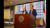 Colorado Secretary of State Jena Griswold, left, and Attorney General Phil Weiser, right, announce they have asked the U.S. Supreme Court to consider an appeals court ruling that presidential electors can vote for the candidate of their choice, at a news conference in Denver, Colorado on Wednesday, Oct. 16, 2019. Griswold and Weiser insist that presidential electors are bound to cast their votes at the Electoral College according to the popular vote in their respective states. (Jesse Paul/The Colorado Sun/via AP)