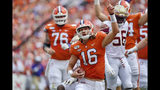 Clemson quarterback Trevor Lawrence (16) reacts after scoring a touchdown during the first half of an NCAA college football game against Florida State, Saturday, Oct. 12, 2019, in Clemson, S.C. (AP Photo/Richard Shiro)