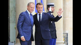 European Council President Donald Tusk, left, is welcomed by French President Emmanuel Macron at the Elysee Palace, Monday, Oct. 14, 2019. French President Emmanuel Macron meets European Council President Donald Tusk ahead of EU summit this week. (AP Photo/Michel Euler)