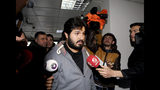 FILE - In this Dec. 17, 2013, file photo, Turkish-Iranian businessman Reza Zarrab, who plead guilty in the U.S. for evading sanctions on Iran, is surrounded by members of the media as he arrives at a courthouse in Istanbul in a separate case against him. Halkbank, a state-owned Turkish bank, was criminally charged in an indictment Tuesday, Oct. 15, 2019, with participating in a multibillion-dollar scheme to evade U.S. sanctions against Iran. The charges against Halkbank were announced years after Zarrab, a wealthy gold trader, was arrested in Florida. In a release, U.S. Attorney Geoffrey S. Berman said senior bank officials designed and carried out the scheme to move billions of dollars of Iranian oil revenue illegally. (Depo Photos via AP, File)