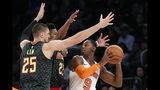 New York Knicks forward RJ Barrett (9) looks to pass with Atlanta Hawks forward Cam Reddish (22) and Hawks center Alex Len (25) defending during the first half of a preseason NBA basketball game in New York, Wednesday, Oct. 16, 2019. (AP Photo/Kathy Willens)
