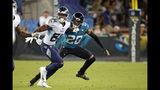 ARCHIVO - En esta foto del jueves 19 de septiembre de 2019, el cornerback de los Jaguars de Jacksonville, Jalen Ramsey (20), cubre al wide receiver de los Titans de Tennessee, Corey Davis (84), durante la primera mitad de un juego de la NFL, en Jacksonville, Florida. (AP Foto/Stephen B. Morton, Archivo)