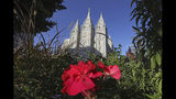 """FILE - This Oct. 4, 2019, file photo, shows the Salt Lake Temple at Temple Square in Salt Lake City. The Church of Jesus of Christ of Latter-day Saints is opposing a proposed ban on conversion therapy in Utah, just months after it said it wouldn't stand in the way of a similar rule under consideration. The church said in a statement posted Tuesday night, Oct. 15, 2019, that the regulatory rule prohibiting Utah psychologists from engaging in LBGTQ conversion therapy with minors would fail to safeguard """"religious beliefs"""" and doesn't account for """"important realities of gender identity in the development of children."""" (AP Photo/Rick Bowmer, File)"""