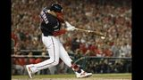 Washington Nationals' Ryan Zimmerman hits a single during the first inning of Game 4 of the baseball National League Championship Series against the St. Louis Cardinals Tuesday, Oct. 15, 2019, in Washington. (AP Photo/Jeff Roberson)