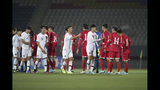 In this photo provided by the Korea Football Association, South Korean players, wearing white, shake hands with North Korean players after Asian zone Group H qualifying soccer match for the 2022 World Cup at Kim Il Sung Stadium in Pyongyang, North Korea, Tuesday, Oct. 15, 2019. (The Korea Football Association via AP)