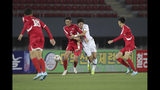 In this photo provided by the Korea Football Association, South Korea's Hwang Ui-jo, center right, fights for the ball against North Korea's Ri Yong Jik during their Asian zone Group H qualifying soccer match for the 2022 World Cup at Kim Il Sung Stadium in Pyongyang, North Korea, Tuesday, Oct. 15, 2019. (The Korea Football Association via AP)