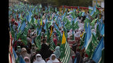 Supporters of Pakistani religious party Jamaat-e-Islami rally to express solidarity with Indian Kashmiris, in Islamabad, Pakistan, Wednesday, Oct. 16, 2019. Pakistani and Indian troops traded fire in the disputed Himalayan region of Kashmir on Wednesday, killing four civilians and wounding nearly a dozen others, officials from both sides said, as tensions remain high between the two South Asian countries. (AP Photo/B.K. Bangash)