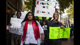 In this Tuesday, Oct. 15, 2019 photo, protesters demonstrating against the killing of Atatiana Jefferson by a white Fort Worth police officer, march down Main Street in downtown Fort Worth, Texas. (Yffy Yossifor/Star-Telegram via AP)