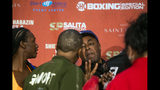 Boxer Ivana Habazin's trainer Bashir Ali, right, trash talks with members of Claressa Shields' entourage during a weigh-in Friday, Oct. 4, 2019, in Flint, Mich. Ali was later punched by a man and fell to the ground bloodied. He was sent to McLaren Hospital in Flint to be treated. Habazin and Claressa Shields are scheduled to fight Saturday for the WBO and WBC super welterweight championships. (Jake May/The Flint Journal via AP)