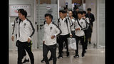 South Korean national soccer team members arrive at Incheon International Airport in Incheon, South Korea, Thursday, Oct. 17, 2019. North Korea held South Korea to a 0-0 draw Tuesday in a World Cup qualifying soccer match played in an empty stadium in Pyongyang, but specific details of the game weren't immediately available. South Korean soccer officials were unable to watch a telecast of the historic game at Kim Il Sung Stadium and South Korean spectators and media were denied entry. (AP Photo/Lee Jin-man)