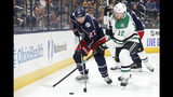 Columbus Blue Jackets' Ryan Murray, left, and Dallas Stars' Radek Faksa, of the Czech Republic, chase the puck during the first period of an NHL hockey game Wednesday, Oct. 16, 2019, in Columbus, Ohio. (AP Photo/Jay LaPrete)