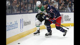 Dallas Stars' Alexander Radulov, left, of Russia, and Columbus Blue Jackets' Nick Foligno chase the puck during the first period of an NHL hockey game Wednesday, Oct. 16, 2019, in Columbus, Ohio. (AP Photo/Jay LaPrete)