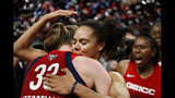 Washington Mystics center Emma Meesseman (33) and guard Kristi Toliver hug after Game 5 of basketball's WNBA Finals against the Connecticut Sun, Thursday, Oct. 10, 2019, in Washington. (AP Photo/Alex Brandon)