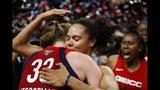 Washington Mystics center Emma Meesseman (33) and guard Kristi Toliver hug after Game 5 of basketball's WNBA Finals against the Connecticut Sun, Thursday, Oct. 10, 2019, in Washington. (AP Photo/Alex Brandon)