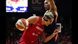 Washington Mystics forward Elena Delle Donne, left, drives against Connecticut Sun forward Alyssa Thomas during the second half of Game 5 of basketball's WNBA Finals, Thursday, Oct. 10, 2019, in Washington. (AP Photo/Alex Brandon)