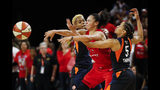 Connecticut Sun guards Courtney Williams, left, and Jasmine Thomas, right, combine to guard Washington Mystics guard Kristi Toliver during the second half of Game 5 of basketball's WNBA Finals, Thursday, Oct. 10, 2019, in Washington. (AP Photo/Alex Brandon)