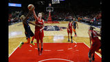 Connecticut Sun guard Courtney Williams, left, shoots as she is guarded by Washington Mystics center Emma Meesseman during the second half of Game 5 of basketball's WNBA Finals, Thursday, Oct. 10, 2019 in Washington. (AP Photo/Alex Brandon)