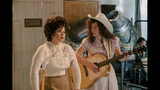"""This image released by Lifetime shows Jessie Mueller as Loretta Lynn, right, and Megan Hilty as Patsy Cline in a scene from the TV film, """"Patsy & Loretta."""" The film airs on Oct. 19 on Lifetime. (Jake Giles Netter/Lifetime via AP)"""