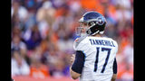 Tennessee Titans quarterback Ryan Tannehill looks to throw a pass during the second half of an NFL football game against the Denver Broncos, Sunday, Oct. 13, 2019, in Denver. (AP Photo/Jack Dempsey)