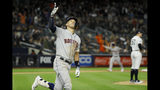 Houston Astros' Carlos Correa, left, celebrates his three-run home run off New York Yankees relief pitcher Chad Green during the sixth inning in Game 4 of baseball's American League Championship Series Thursday, Oct. 17, 2019, in New York. (AP Photo/Matt Slocum)