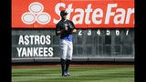 New York Yankees left fielder Giancarlo Stanton waits for balls in the outfield during batting practice before Game 3 of baseball's American League Championship Series against the Houston Astros, Tuesday, Oct. 15, 2019, in New York. (AP Photo/Matt Slocum)