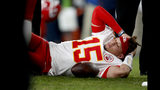 Kansas City Chiefs quarterback Patrick Mahomes (15) lies on the field after being injured against the Denver Broncos during the first half of an NFL football game, Thursday, Oct. 17, 2019, in Denver. (AP Photo/David Zalubowski)