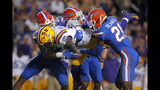 Florida linebacker David Reese II, left, defensive back Donovan Stiner and defensive back Trey Dean III (21) upend LSU tight end Stephen Sullivan (10) on a reception in the first half of an NCAA college football game in Baton Rouge, La., Saturday, Oct. 12, 2019. (AP Photo/Gerald Herbert)