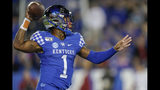 Kentucky quarterback Lynn Bowden Jr. throws a pass during the first half of the team's NCAA college football game against Arkansas, Saturday, Oct. 12, 2019, in Lexington, Ky. (AP Photo/Bryan Woolston)