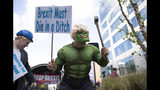 A protestor is dressed in an Incredible Hulk costume as he participates in an anti-Brexit demonstration outside of an EU summit in Brussels, Thursday, Oct. 17, 2019. The European Union says Brexit negotiations are plowing on after intense talks in recent days, as EU leaders converge on Brussels for a key summit aimed at sealing a new divorce agreement. (AP Photo/Virginia Mayo)