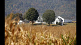 This Oct. 1, 2019 photo shows a farm house on a farm owned by the family of West Virginia Gov. Jim Justice near Lewisburg, W.Va. Justice Farms of North Carolina raked in tens of thousands of taxpayer dollars under a subsidy program President Donald Trump set up to help farmers hurt by his trade war with China. (AP Photo/Steve Helber)