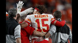 Kansas City Chiefs quarterback Patrick Mahomes (15) leaves the game after getting injured against the Denver Broncos during the first half of an NFL football game, Thursday, Oct. 17, 2019, in Denver. (AP Photo/David Zalubowski)