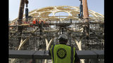 In this Oct. 8, 2019 photo, an employee of the Dubai Expo 2020 visits the Al Wasl Dome at the under construction site of the Expo 2020 in Dubai, United Arab Emirates. (AP Photo/Kamran Jebreili)