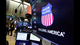 FILE - In this Sept. 13, 2019, file photo the logo for Union Pacific appears above a trading post on the floor of the New York Stock Exchange. Union Pacific Corp. reports financial results Thursday, Oct. 17. (AP Photo/Richard Drew, File)