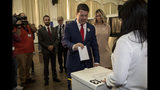 Chief Minister of Gibraltar Fabian Picardo places his vote during general elections in Gibraltar, Thursday Oct. 17, 2019. An election for Gibraltar's 17-seat parliament is taking place Thursday under a cloud of uncertainty about what Brexit will bring for this British territory on Spain's southern tip. (AP Photo/Javier Fergo)