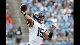 Jacksonville Jaguars quarterback Gardner Minshew (15) passes against the Carolina Panthers during the first half of an NFL football game in Charlotte, N.C., Sunday, Oct. 6, 2019. (AP Photo/Brian Blanco)