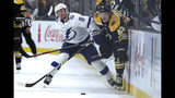 Tampa Bay Lightning center Tyler Johnson (9) and Boston Bruins left wing Danton Heinen (43) compete for the puck during the first period of an NHL hockey game Thursday, Oct. 17, 2019, in Boston. (AP Photo/Elise Amendola)