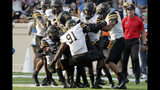 FILE - In this Sept. 21, 2019, file photo, Appalachian State's Akeem Davis-Gaither (24) is mobbed by his teammates as he celebrates his interception against North Carolina during the third quarter of an NCAA college football game in Chapel Hill, N.C. No. 24 Appalachian State are ranked for the second time ever. They take on Louisiana-Monroe at home on Saturday, Oct. 19. (AP Photo/Chris Seward, File)