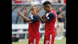 FC Dallas midfielder Michael Barrios (21) dances with forward Jesus Ferreira (27) after Ferreira scored a goal against Sporting Kansas City during the second half of an MLS soccer match in Frisco, Texas, Sunday, Oct. 6, 2019. (Stewart F. House/The Dallas Morning News via AP)