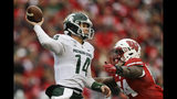Michigan State quarterback Brian Lewerke (14) passes against Wisconsin linebacker Chris Orr (54) during the first half of an NCAA college football game Saturday, Oct. 12, 2019, in Madison, Wis. (AP Photo/Andy Manis)