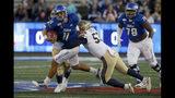 Tulsa quarterback Zack Smith (11) is taken down by Navy's Tama Tuitele during an NCAA college football game, Saturday, Oct. 12, 2019, in Tulsa, Okla. (Stephen Pingry/Tulsa World via AP)