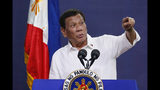 FILE - In this Aug. 27, 2019, file photo, Philippine President Rodrigo Duterte addresses land reform beneficiaries on the 31st year of the implementation of the Comprehensive Agrarian Reform Program (CARP) in suburban Quezon city, northeast of Manila, Philippines. A spokesman said Thursday, Oct. 17, 2019, Duterte was bruised and scratched from falling off his parked motorcycle at the palace grounds. (AP Photo/Bullit Marquez, File)