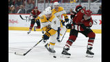 Nashville Predators defenseman Dan Hamhuis (5) and Arizona Coyotes right wing Michael Grabner (40) vie for the puck during the second period of an NHL hockey game Thursday, Oct. 17, 2019, in Glendale, Ariz. (AP Photo/Rick Scuteri)