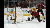 Nashville Predators goaltender Juuse Saros (74) makes a save on Arizona Coyotes left wing Lawson Crouse (67) during the second period of an NHL hockey game Thursday, Oct. 17, 2019, in Glendale, Ariz. (AP Photo/Rick Scuteri)