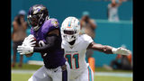 FILE - In this Sept. 8, 2019, file photo, Baltimore Ravens free safety Earl Thomas (29) intercepts a pass, as Miami Dolphins wide receiver DeVante Parker (11), attempts to tackle, during the first half at an NFL football game, in Miami Gardens, Fla. Over the course of nine NFL seasons with the Seattle Seahawks, Earl Thomas picked off 28 passes, earned a Super Bowl ring and was selected to the Pro Bowl six times. Those are some of the memories the standout safety will take across the country before he faces former team on Sunday as a member of the Baltimore Ravens.(AP Photo/Wilfredo Lee, File)