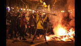 Protestors make barricades in the street during clashes with police in Barcelona, Spain, Wednesday, Oct. 16, 2019. Spain's government said Wednesday it would do whatever it takes to stamp out violence in Catalonia, where clashes between regional independence supporters and police have injured more than 200 people in two days. (AP Photo/Emilio Morenatti)