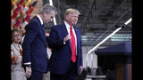 President Donald Trump arrives with Bernard Arnault, chief executive of LVMH during a ribbon cutting ceremony with at the Louis Vuitton Workshop Rochambeau in Alvarado, Texas, Thursday, Oct. 17, 2019. (AP Photo/Andrew Harnik)